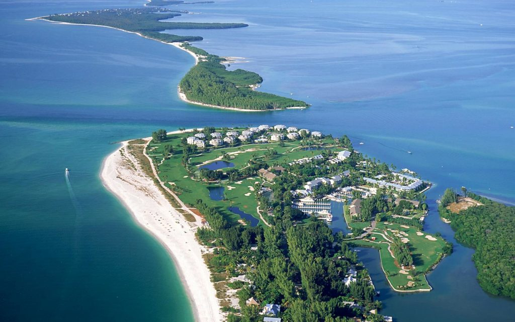 sanibel island in florida with blue water and white sand and residential homes
